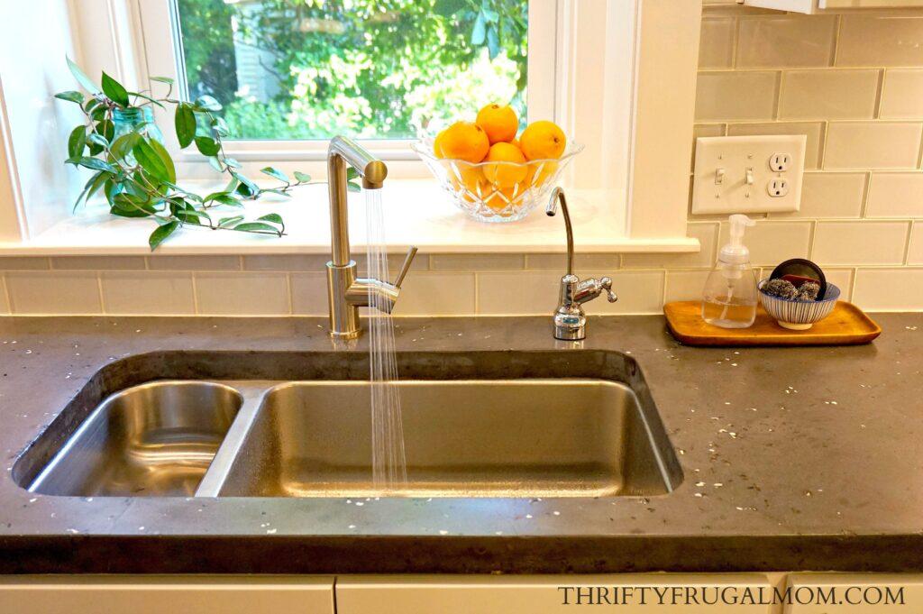 Gray Concrete Counter Top in White Kitchen